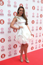 Michelle Heaton rocked a white cocktail dress with a gold embellished sleeve while on the Tesco Mum of the Year red carpet.