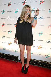 Kesha completed her look with platform ankle booties.