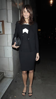 Helena Christensen looks timeless in dainty black heels with silver ankle straps. The heels were a delicate addition to a black sheath dress.