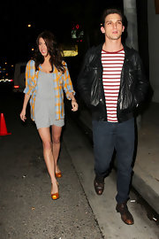 Jacqueline MacInnes Wood added some color to her gray mini dress with a plaid button-down during a night out.