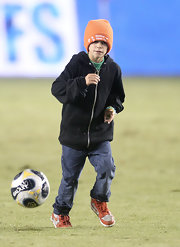 "Romeo hits the field to celebrate with dad in an orange knit beanie embroidered with the phrase ""15 Seconds of No Thank You."""