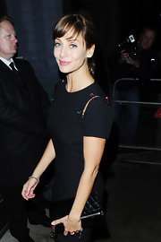 Natalie Imbruglia sported a minimalist LBD and quilted black Chanel clutch combo for David Walliams and Lara Stone's wedding reception.
