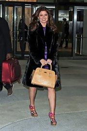 Debra Messing gave her glammed up 'Today Show' look a ladylike finish with a structured satchel.