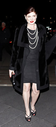 Debra Messing looked elegant in a velvet evening coat and tiered pearls.