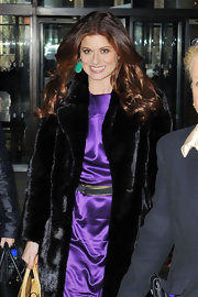 Debra Messing wore her ultra-shiny locks in bouncy curls during an appearance on 'Live With Kelly.""