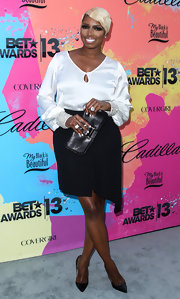 NeNe Leakes rocked black and white at the Pre-BET Awards Celebration Dinner where she donned a white silk blouse and an asymmetrical skirt.