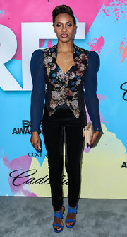 MC Lyte balanced out her puffed jacket with these black skinny pants.