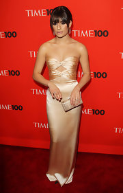 """Glee"" star Lea Michele showed off her glamorous side while hitting the red carpet at the Time 100 event. Her box clutch was just the right accent to her sassy dress."