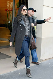 Demi Moore bundled up in Paris wearing a thick coat with large statement shoulders and a rich texture.