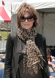 Lisa Rinna wore an animal print scarf at the Best Friends Animal Society pet adoption festival. She looked cool and casual pairing the piece with a leather jacket and boots.