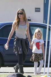 Denise Richards was a natural beauty at her daughter's soccer game in a simple heather gray tank top and leggings.