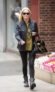 Denise van Outen chose a pair of skinny leather leggins for her look while London.