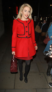Lydia Rose Bright's red evening coat had a charming retro feel.