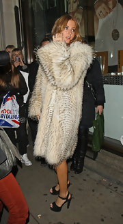 Millie Mackintosh was spotted hiding her Herve dress inside a fur coat at 'A Night with Nick Ede.'