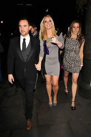 Liz Mcclarnon attended the Priscilla Parties launch looking chic in gray. She wore a sweater dress and basic pumps.