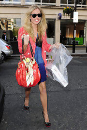 Diana Vickers made her way up to BBC radio station donning a blue dress, red and white polka dot jacket and a red hobo bag, which she adorned with a scarf.