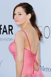Rose McGowan made the classic ponytail sexy with this sleek version featuring long side-swept bangs.