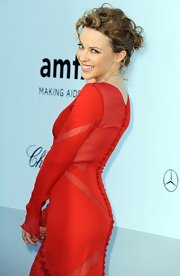 Kylie Minogue hit the red carpet at the amfAR Gala wearing her curly tresses in an adorable bobby pinned updo.