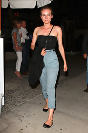 Diane looked effortlessly chic in blue, high-waisted pants paired with a simple tube top and flats.