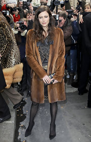 Anna wears a long fur coat for the Chanel fashion show in Paris.