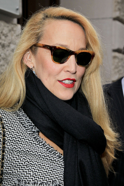 Jerry Hall looked polished at the Chanel Haute Couture fashion show in tortoiseshell wayfarer sunglasses.
