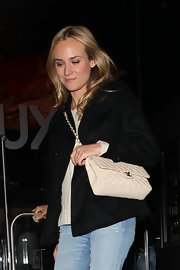 Diane Kruger dined out carrying a chic quilted cream Chanel bag.