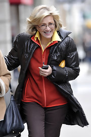 Diane Sawyer kept warm with a black down jacket while running errands in NYC.
