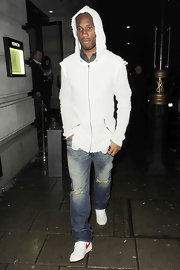 Didier Drogba paired ripped jeans with a frayed hoodie for a totally edgy look.