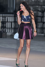 Eliza dons a purple iridescent pleated skirt with a crop top for the Royal Academy of Arts party.