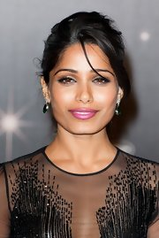 Freida Pinto looked lovely at the 'Moonrise Kingdom' screening wearing shimmery metallic eyeshadow and dramatic liner.