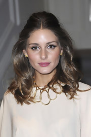 Olivia Palermo wore her hair half up and with long loose waves at the Christian Dior fashion show in Paris.