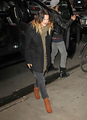 Drew Barrymore took to 'Good Morning America' in casual skinny jeans and cognac lace-up boots.