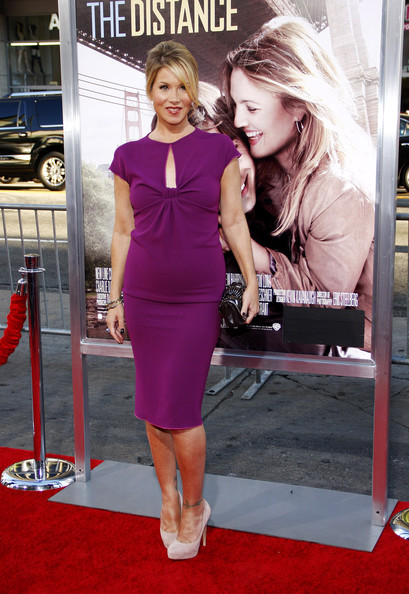 Christina showed off her vibrant purple cocktail dress, which she paired with nude suede pumps.