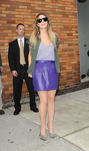 Drew paired her vibrant purple skirt with a green cargo button down shirt.