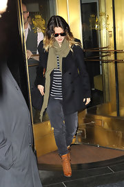 Drew Barrymore fought the NY cold in an olive scarf.