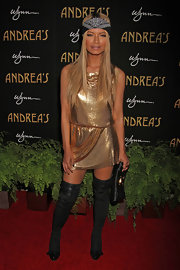 Havana Brown looked stunning as she matched her sun-kissed skin tone with a gold cocktail dress at the opening of Andrea's restaurant.