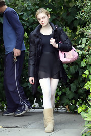Elle Fanning stayed cozy in a pair of tan sheepskin boots.