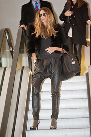 Elle attended 'Britain's Next Top Models' in black studded cutout booties.
