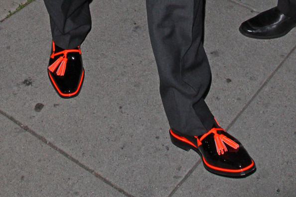 Elton John spiced up the classic loafer with this pair of orange trim tassel loafers.