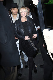 Emma wore an edgy leather motorcycle jacket wore and LBD and tights.