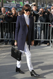 Ines de la Fressange wore black leather buckled ankle boots to the Chanel show.
