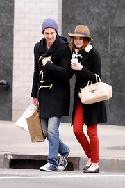 Emma Stone added kick to her stylish winter wear with a pair of on-trend red skinny jeans.
