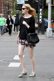 Emma Stone spent the day out in NYC wearing a pair of cute mint green oxfords.