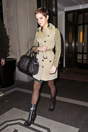 Emma wore a studded trench coat while out in New York. She paired this look with darling polka-dot tights.