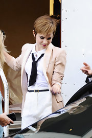 Emma Watson embraced the menswear trend while filming a spot for Lancome in a loose black necktie.