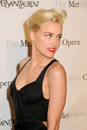 Amber Heard attended the Metropolitan premiere of 'Manon' wearing her hair in a classic French twist with voluminous side-swept bangs.