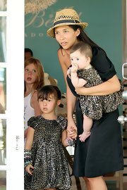 Myleene Klass wore a straw hat with her single-sleeve LBD while shopping in Barbados.