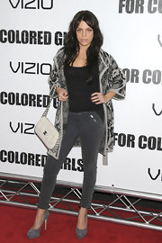 Vanessa Ferlito posed in a pair of gray suede pumps. Vanessa wore matching gray denim with the platform heels.