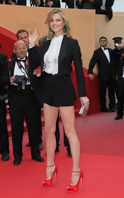 Eva Herzigova put her best foot, and leg forward in sizzling red satin peep-toe pumps with delicate ankle straps.