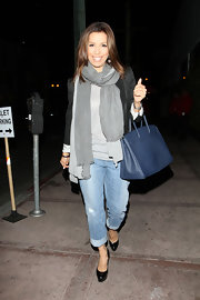"Actress Eva Longoria loves her navy ""Birkin"" bag. She has been seen toting the bag around LA for the past several weeks and we can see why. The bags goes with virtually everything."
